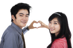 Couple showing heart shape with hands Royalty Free Stock Photos