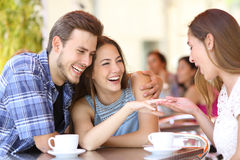 Couple showing his engagement ring to a friend. In a coffee shop Royalty Free Stock Photos