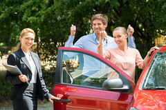 Couple Showing Key Of Newly Purchased Car Stock Photography