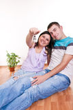Couple showing keys to new apartment. Happy smiling young couple showing keys to new apartment Royalty Free Stock Image