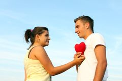 Couple showing love. Lovely couple holding a heart Royalty Free Stock Photo