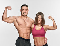 Couple showing muscles Royalty Free Stock Image