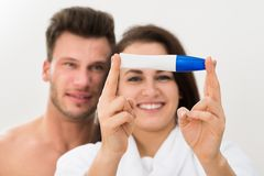 Couple showing positive pregnancy test Stock Images