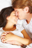 Couple showing romance on bed Stock Image