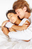 Couple showing romance on bed Stock Photography