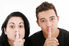 Couple showing silence Stock Photography