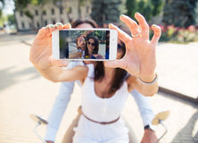 Couple showing smartphone screen while making selfie photo Royalty Free Stock Images