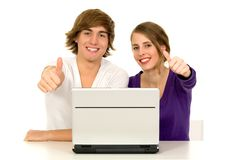 Couple showing thumbs up. Couple using laptop showing thumbs up Royalty Free Stock Images