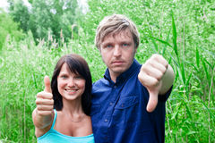 Couple showing thumbs Stock Photo