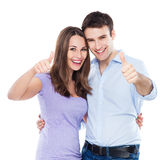 Couple showing thumbs up. Over white background Stock Images