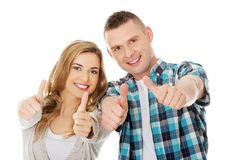 Couple showing thumbs up. Young attractive couple showing thumbs up Royalty Free Stock Photos