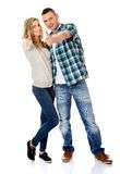 Couple showing thumbs up. Young attractive couple showing thumbs up Stock Images