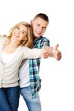 Couple showing thumbs up. Young attractive couple showing thumbs up Royalty Free Stock Photography