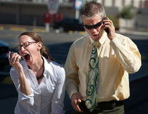 Couple shows displeasure with conversation. Couple is upset with people on the opposite end of the line Stock Photo