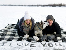 Couple and Siberian huskies Royalty Free Stock Image