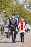 Couple at side walk on sunny day, Beijing, China stock image