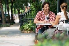 Couple At Sidewalk Cafe. Couple drinking wine at sidewalk cafe Stock Photography