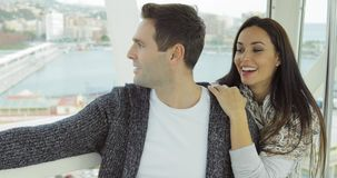 Couple sightseeing on a cable car or ferris wheel stock footage