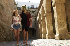 Couple sightseeing in Ibiza, looking at each other Royalty Free Stock Photography