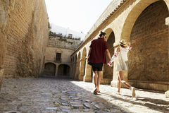 Couple sightseeing old buildings, back view, Ibiza, Spain Royalty Free Stock Photography