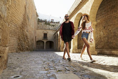 Couple sightseeing old buildings, front view, Ibiza, Spain Stock Photography