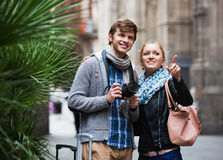 Couple sightseeing and taking pictures of city Stock Images