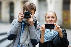 Couple sightseeing and taking pictures Royalty Free Stock Image