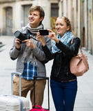 Couple sightseeing and taking pictures Stock Image