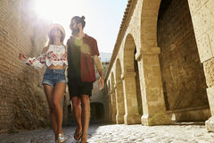 Couple sightseeing on vacation, lens flare, Ibiza, Spain Royalty Free Stock Photos