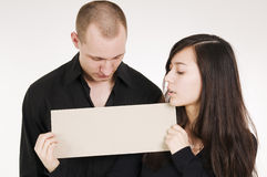 Couple with sign Royalty Free Stock Images