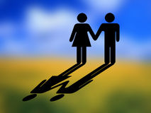 Couple, sign mode. A couple with shadow on the background of blured landscape. Couple made like a sign style Stock Image