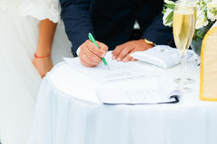 Couple Signatures on the Wedding. Wedding ceremony. Wedding couple leaving their signatures Stock Images