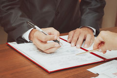 The couple signed their first document Stock Photography
