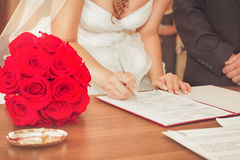 The couple signed their first document Royalty Free Stock Photo