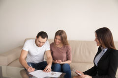 Couple signing agreement for buying renting apartment, mortgage Royalty Free Stock Photos
