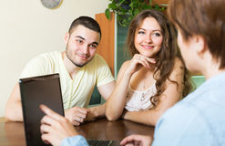 Couple signing agreement at home Royalty Free Stock Image