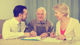 Couple signing agreement Stock Photography