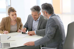 Couple signing a construction contract Royalty Free Stock Image