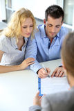 Couple signing contract Royalty Free Stock Photo