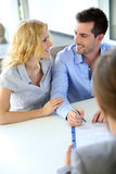 Couple signing contract Stock Photography
