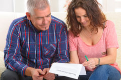 Couple signing health insurance contract royalty free stock photo