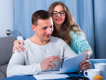 Couple signing papers Royalty Free Stock Images