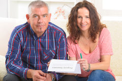 Couple signing property insurance contract stock photography