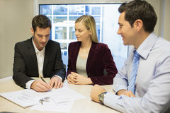 Couple signing real-estate contract Stock Image