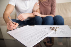 Couple signing rental agreement, renting and tenancy, getting ke Stock Images