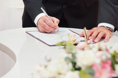 Couple signs documents Stock Image
