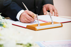 Couple signs documents Stock Photos