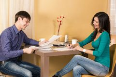 Couple signs documents Royalty Free Stock Image