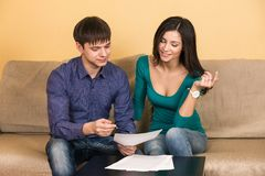 Couple signs documents Stock Images