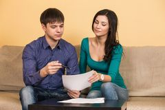 Couple signs documents Royalty Free Stock Images
